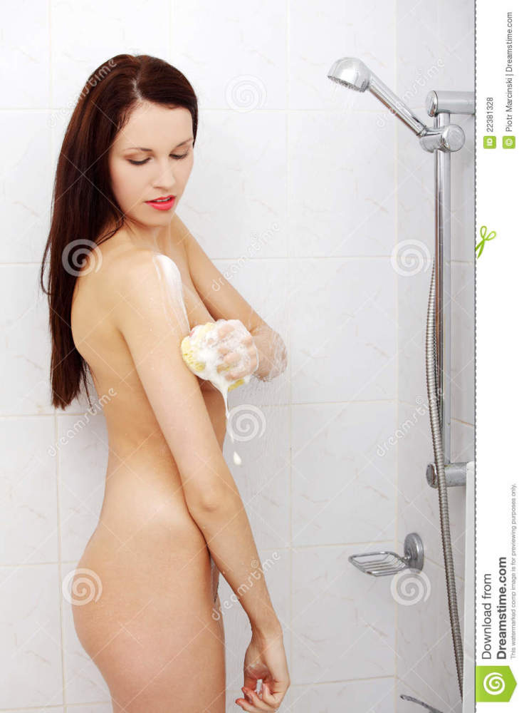 Girl taking a shower. stock photo...