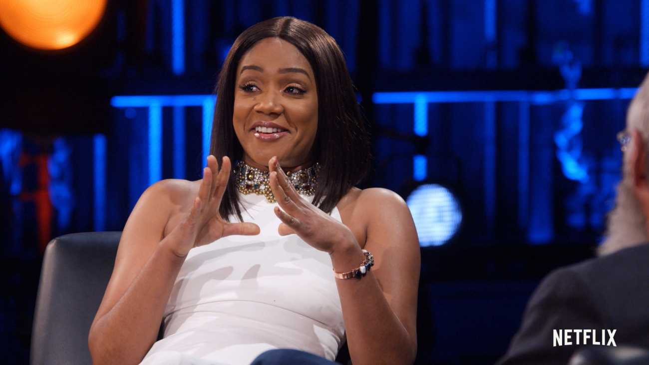 Tiffany Haddish stretches to David..