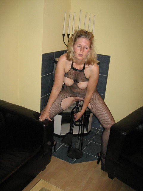 Highly inviting housewife in fishnets..