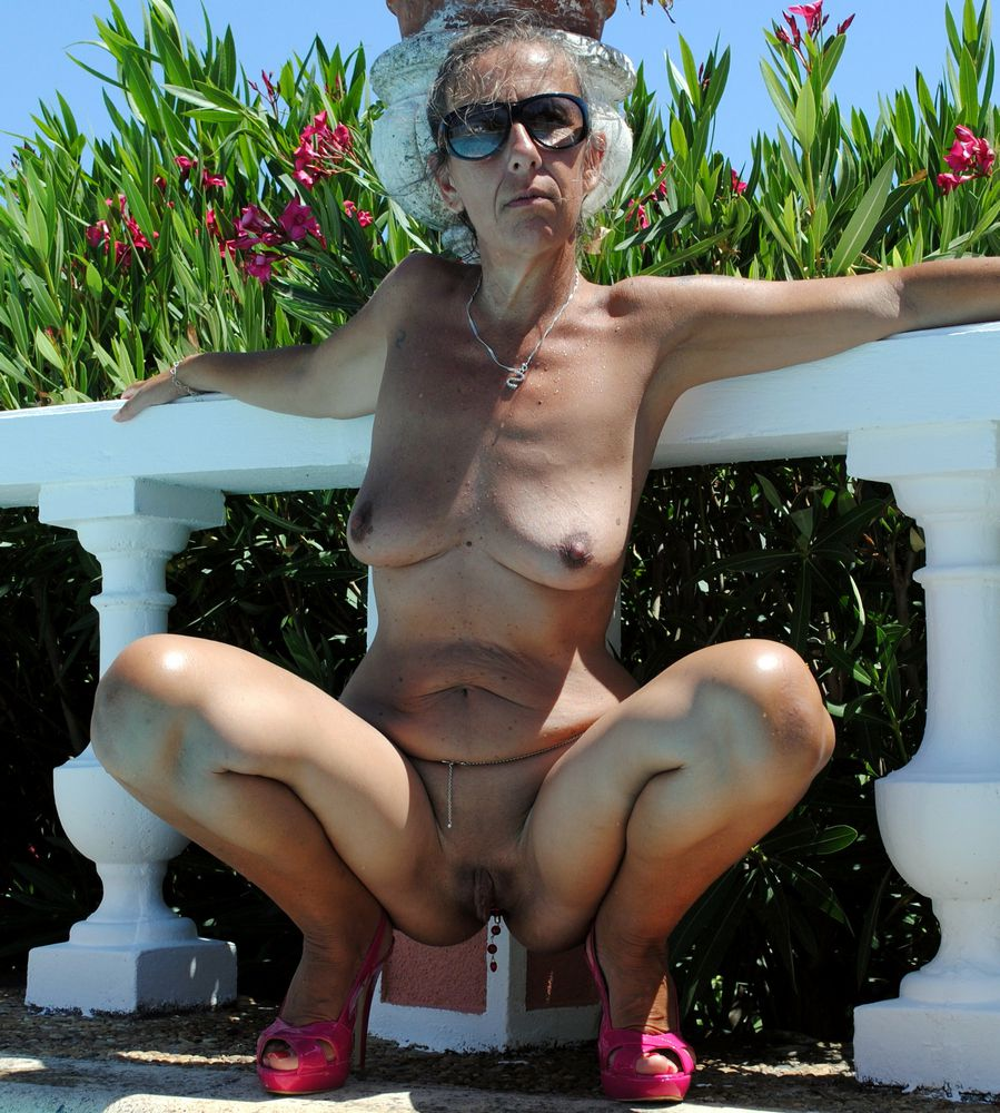 Completely nude mature nymphs with..